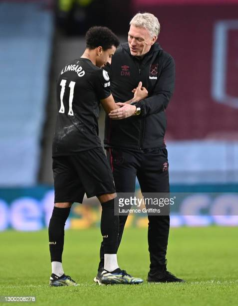 David Moyes, Manager of West Ham United reacts with Jesse Lingard of West Ham United during the Premier League match between Aston Villa and West Ham...