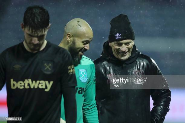 David Moyes, Manager of West Ham United smiles with Darren Randolph of West Ham United following the FA Cup Third Round match between Stockport...
