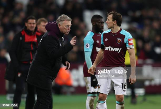 David Moyes manager of West Ham United speaks with Mark Noble of West Ham United during the Premier League match between West Ham United and AFC...