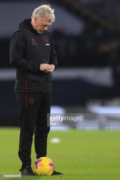 David Moyes, Manager of West Ham United takes notes during the warm up prior to the Premier League match between Fulham and West Ham United at Craven...