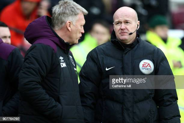 David Moyes manager of West Ham United talks to fourth official Lee Mason before the Premier League match between West Ham United and AFC Bournemouth...