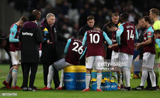 David Moyes manager of West Ham United talks to his team during the Emirates FA Cup Third Round Replay match between West Ham United and Shrewsbury...