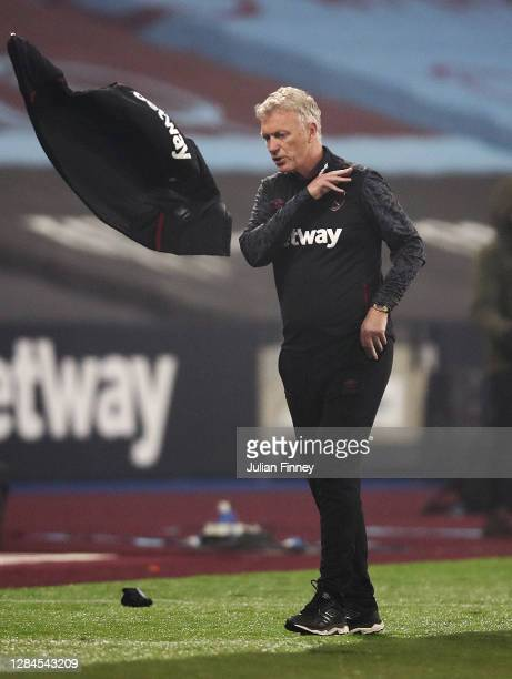 David Moyes, Manager of West Ham United throws his jacket in frustration after his team conceded an injury time penalty during the Premier League...