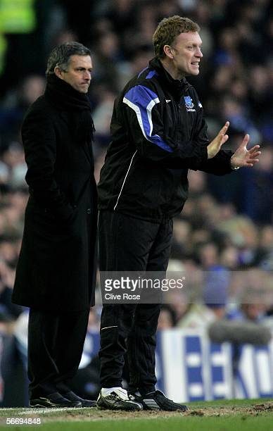 David Moyes of Everton and Jose Mourinho of Chelsea look on during the FA Cup 4th Round match between Everton and Chelsea at Goodison Park on January...