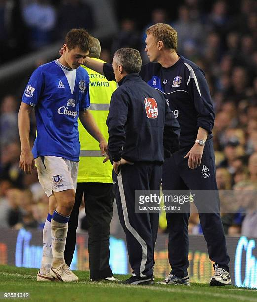 David Moyes of Everton consoles Diniyar Bilyaletdinov after being sent off during the Barclays Premier League match between Everton and Aston Villa...