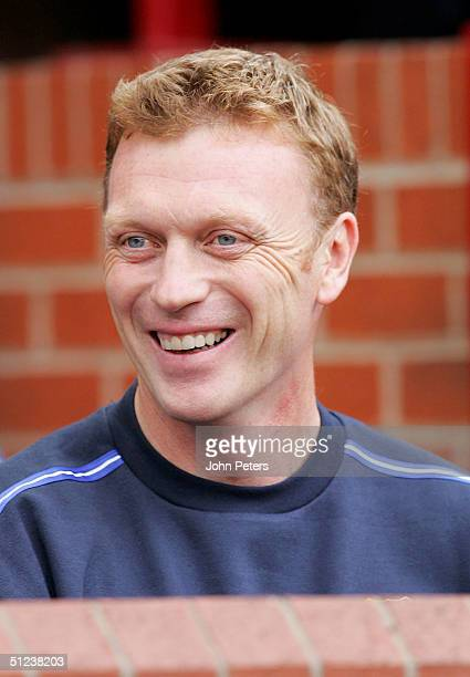 David Moyes of Everton smiles during the Barclays Premiership match between Manchester United and Everton at Old Trafford on August 30 2004 in...