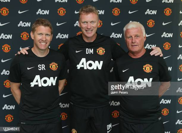David Moyes of Manchester United poses with assistant manager Steve Round and coach Jimmy Lumsden on their first day of work as the club's new...