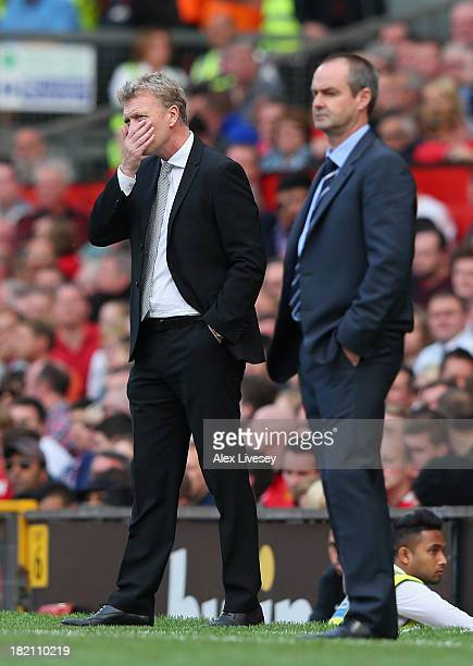 David Moyes the manager of Manchester United looks on alongside Steve Clarke the manager of West Bromwich Albion during the Barclays Premier League...