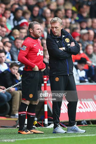 David Moyes the manager of Manchester United passes on final instructions as Wayne Rooney comes on as a substitute during the Barclays Premier League...