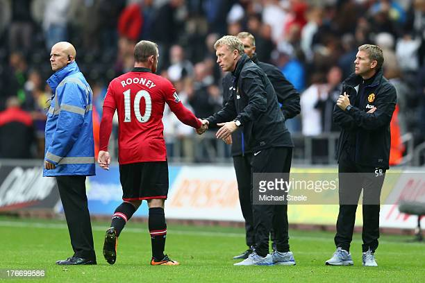 David Moyes the manager of Manchester United shakes hands with Wayne Rooney after the final whistle during the Barclays Premier League match between...