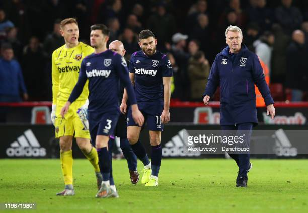 David Moyes the manager of West Ham United and Robert Snodgrass walk off at the end of the Premier League match between Sheffield United and West Ham...