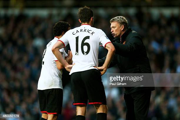 David Moyes the Manchester United manager speaks with Rafael and Michael Carrick of Manchester united during the Barclays Premier League match...