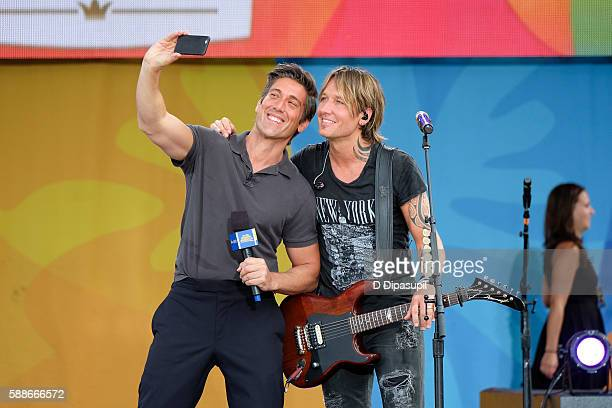 David Muir and Keith Urban take a selfie during ABC's 'Good Morning America' at SummerStage at Rumsey Playfield Central Park on August 12 2016 in New...