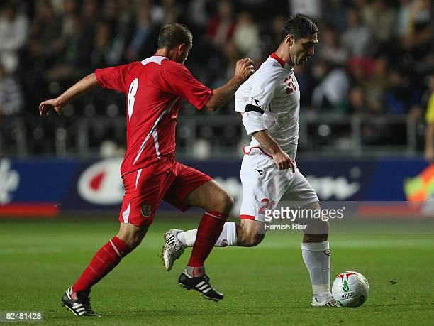 David Mujiri of Georgia contests with Carl Fletcher of Wales during the International Friendly match between Wales and Georgia at The Liberty Stadium...