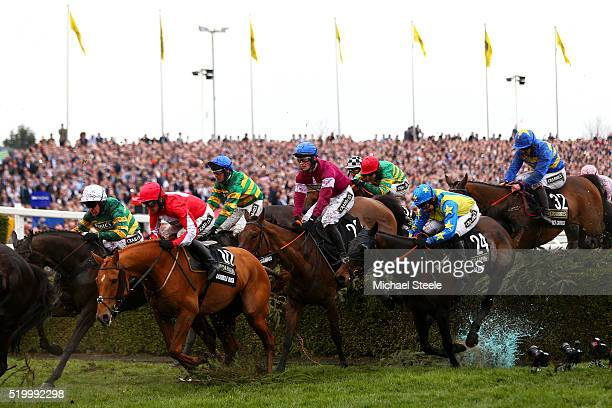 David Mullins clears the water jump on Rule The World on their way to victory in the 2016 Crabbie's Grand National at Aintree Racecourse on April 9...