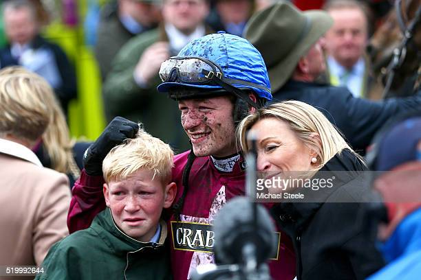 David Mullins poses in the Winners' Enclosure with his brother Charlie and mother Helen after riding Rule The World to victory in the 2016 Crabbie's...