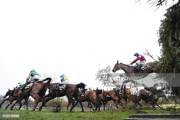 David Mullins riding Rule The World clears a jump on the way to winning the Crabbie's Grand National steeplechase at Aintree Racecourse on April 9...