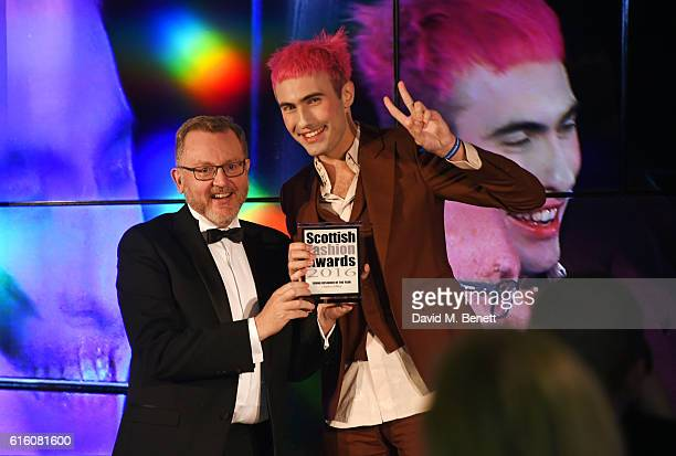 David Mundell MP Secretary of State for Scotland and Charles Jeffrey winner of the Young Designer of the Year award attend the Scottish Fashion...