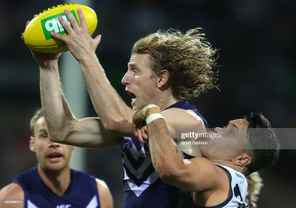 David Mundy of the Dockers and Mathew Stokes of the Cats compete for the ball during the round 20 AFL match between the Geelong Cats and the Fremantle Dockers at Skilled Stadium on August 9, 2014 in Geelong, Australia.