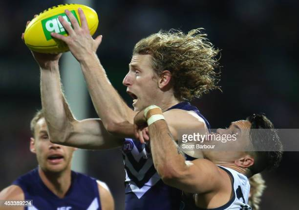 David Mundy of the Dockers and Mathew Stokes of the Cats compete for the ball during the round 20 AFL match between the Geelong Cats and the...