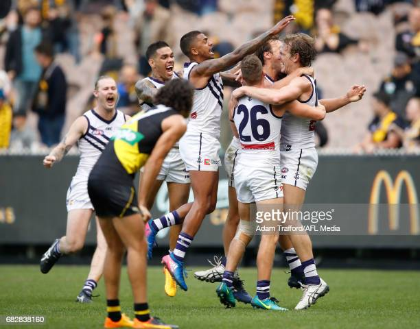David Mundy of the Dockers celebrates a goal after the siren to win the match with teammates during the 2017 AFL round 08 match between the Richmond...