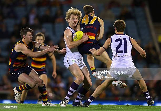 David Mundy of the Dockers clashes with Matthew Wright of the Crows during the AFL Second Semi Final match between the Adelaide Crows and the...