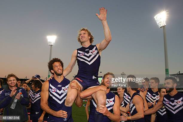 David Mundy of the Dockers is chaired from the field by Zac Clarke and Paul Duffield after playing his 200th game during the round 15 AFL match...
