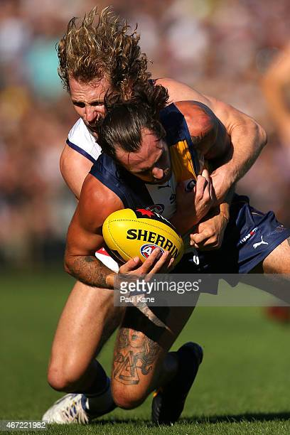 David Mundy of the Dockers tackles Chris Masten of the Eagles during the NAB Challenge AFL match between the West Coast Eagles and the Fremantle...
