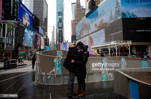 David Murcia and Lorena Rosa kiss each other after a surprise proposal during Valentine's Day festivities in Times Square on February 14, 2021 in New...