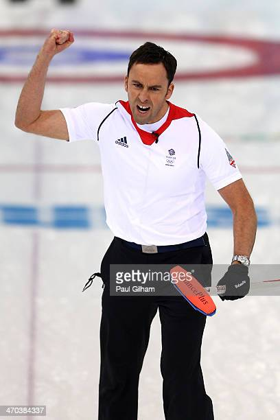 David Murdoch of Great Britain celebrates winning with the final stone in the men's semifinal match between Sweden and Great Britain at Ice Cube...
