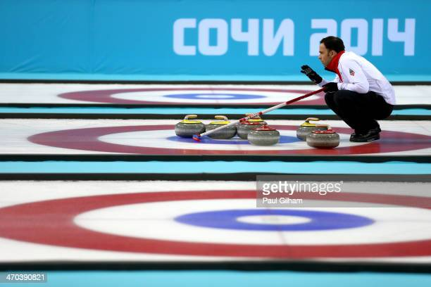 David Murdoch of Great Britain lines up a move with his teammates during the men's semifinal match between Sweden and Great Britain at Ice Cube...
