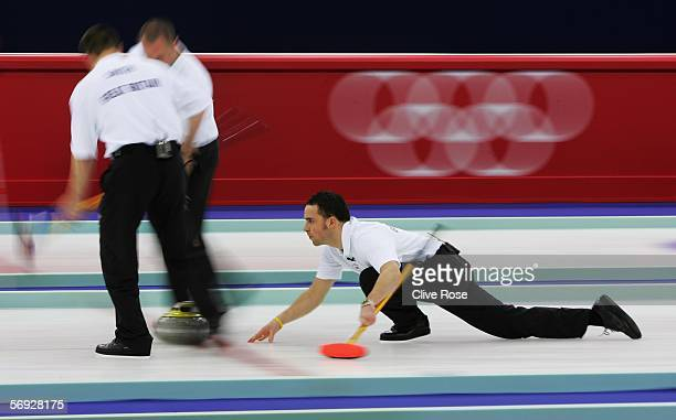 David Murdoch of Great Britain releases a stone during the Gold medal match of the men's curling between United States and Great Britain during Day...