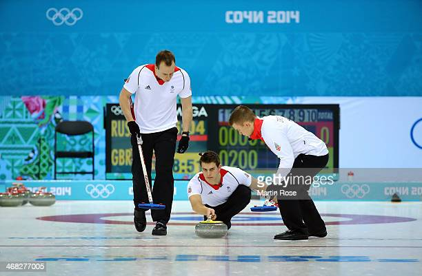 David Murdoch of Great Britain releases a stone during the Men's Curling Round Robin match between Russia and Great Britain on day 3 of the Sochi...