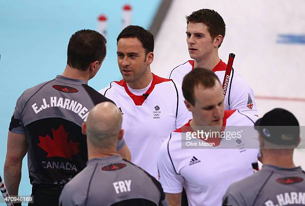 David Murdoch of Great Britain shakes hands with EJ Harnden of Canada as Canada win gold during the Men's Gold Medal match between Canada and Great...