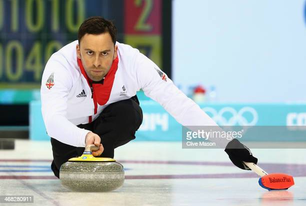 David Murdoch of Great Britrain in action during the round robin match against Russia during day 3 of the Sochi 2014 Winter Olympics at Ice Cube...