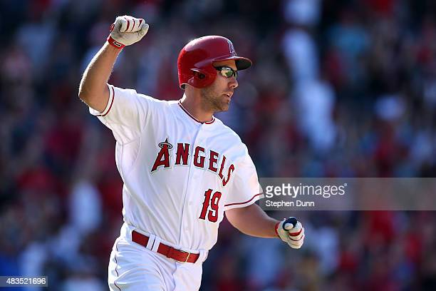 David Murphy of the Los Angeles Angels of Anaheim celebrates as he runs to first base after hitting a walk off RBI single in the 11th inning against...