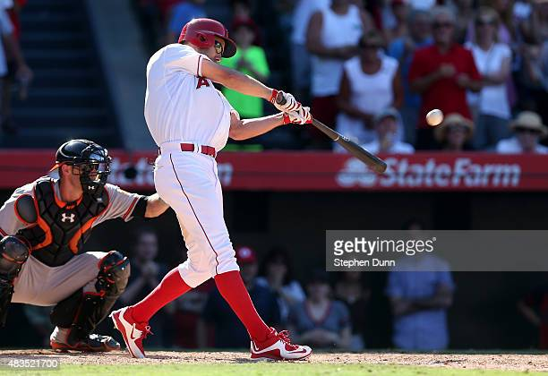 David Murphy of the Los Angeles Angels of Anaheim hits a walk off RBI single in the 11th inning against the Baltimore Orioles at Angel Stadium of...