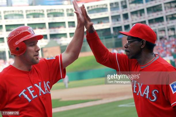 David Murphy of the Texas Rangers celebrates with Ron Washington Manager of the Texas Rangers after Hamilton hit the game winning RBI double in the...