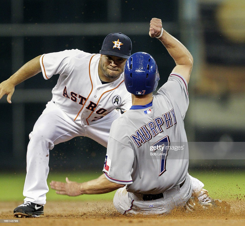 David Murphy #7 of the Texas Rangers is tagged out by Jose Altuve #27 of the Houston Astros attempting to steal second base on Opening Day at Minute Maid Park on March 31, 2013 in Houston, Texas.