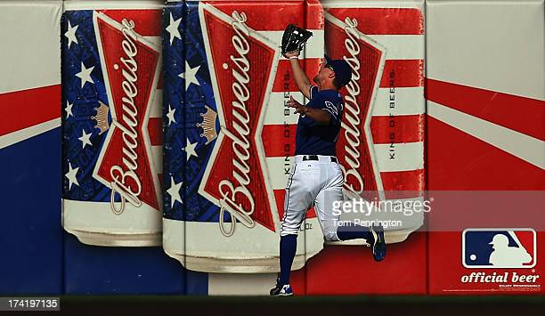 David Murphy of the Texas Rangers pulls in a fly ball for the out against the Baltimore Orioles in the top of the fourth inning at Rangers Ballpark...
