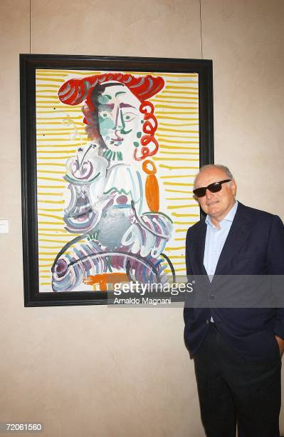 David Nahmad poses in front of a Picasso painting at the Helly Nahmed Gallery in the Carlysle Hotel on October 1 2006 in New York City