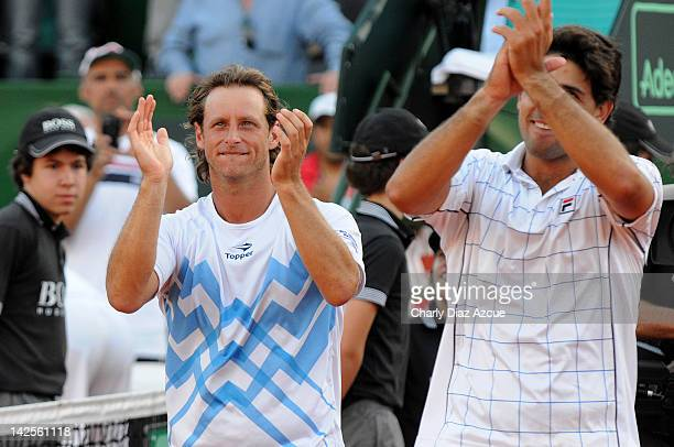 David Nalbandian and Eduardo Schwank celebrate during the match between Argentina and Croatia for the quarterfinals of the Davis Cup at Mary Teran de...