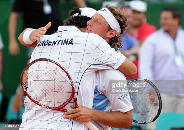 David Nalbandian and Eduardo Schwank of Argentina celebrate during the match between Argentina and Croatia for the quarterfinals of the Davis Cup at...