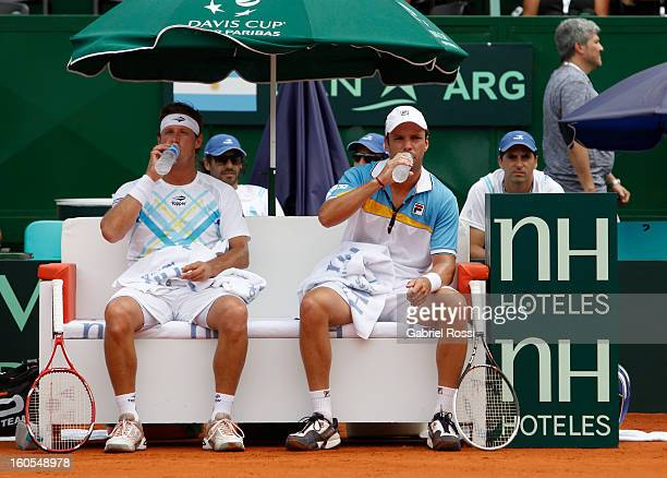 David Nalbandian and Horacio Zeballos of Argentina rest during the match against Christopher Kas and Tobias Kamke of Germany on the second day of...