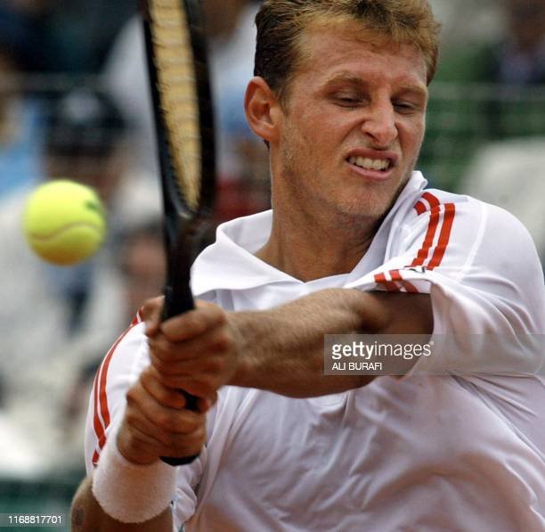 David Nalbandian from Argentina hits a return to German Lars Burgsmuller 07 February 2003 during Davis Cup tennis match in Buenos Aires Argentina AFP...