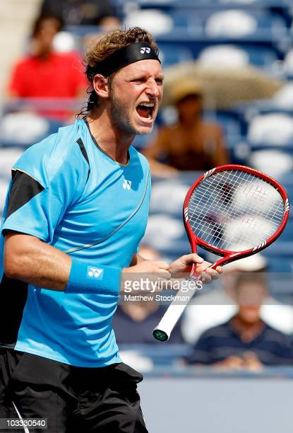 David Nalbandian of Argentina celebrates match point against David Ferrer of Spain during the Rogers Cup at the Rexall Centre on August 10, 2010 in...