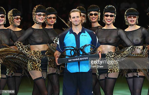 David Nalbandian of Argentina celebrates with the trophy after beating Rafael Nadal of Spain in the Mens Final during the ATP Masters Series at the...