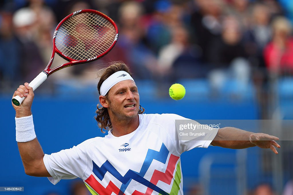 David Nalbandian of Argentina hits a forehand return during his mens singles semi-final match against Grigor Dimitrov of Bulgaria on day six of the AEGON Championships at Queens Club on June 16, 2012 in London, England.
