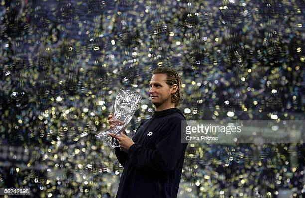 David Nalbandian of Argentina holds the trophy after his five set victory against Roger Federer of Switzerland in the final of the ATP Masters Cup on...