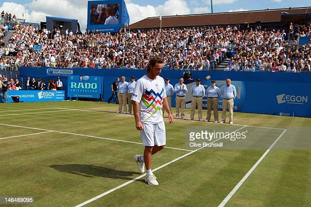 David Nalbandian of Argentina leaves the court dejected after being disqualified for unsportsmanlike conduct during his mens singles final round...